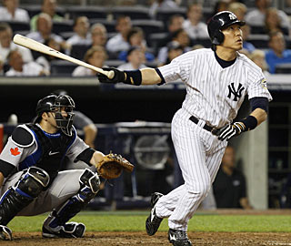 Hideki Matsui takes this 3-2 pitch from Jesse Carlson out of the park to tie the game in the eighth inning. (AP)