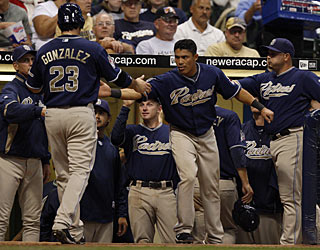 Teammates can't wait for Adrian Gonzalez, who is the first with six hits in a 9-inning game for the Padres. (AP)