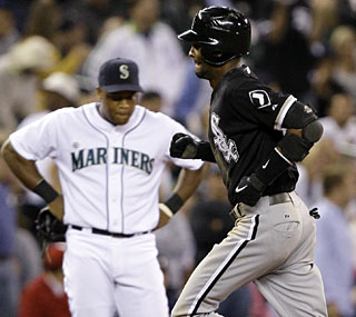 Alexei Ramirez rounds the bases after his three-run homer in the ninth puts Chicago ahead.  (AP)
