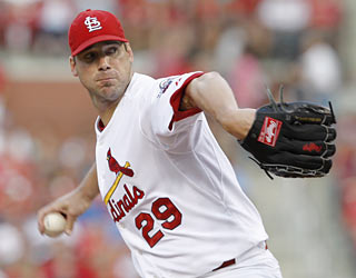 Chris Carpenter matches a season-best 10 strikeouts as he continues to tame the Reds' offense.  (AP)