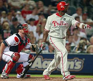 There it goes. Ryan Howard drives a 2-1 pitch from Rafael Soriano for his 28th homer of the year. (AP)