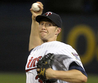 Scott Baker fans five and uses just 94 pitches to collect a two-hit gem against the Indians for his 10th win. (AP)