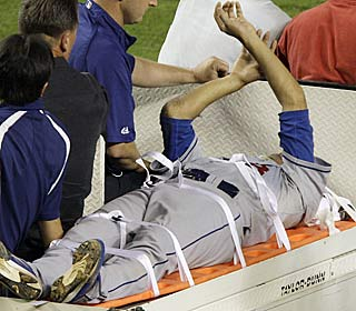 Hiroki Kuroda is carted off the field after being struck in the head by a line drive in the sixth.  (AP)