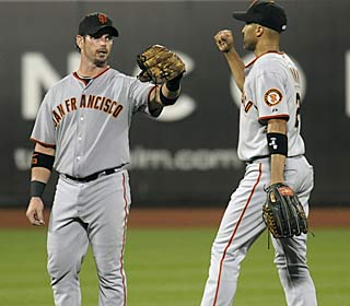 Aaron Rowand (left) receives some well-earned props after collecting four hits, including a homer.  (AP)