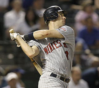 Joe Mauer provides more than his share of offense as he blasts a pair of home runs against the Rangers.  (AP)