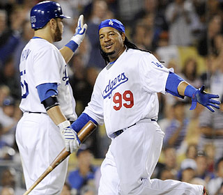 Russell Martin and Manny Ramirez share a laugh and a smile during a three-run rally in the fifth. (AP)