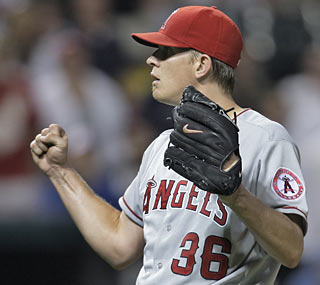 It's a feel-good moment for Jered Weaver, who riddles the Indians through nine frames.  (AP)