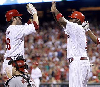 Jayson Werth and Ryan Howard enjoy Werth's two-run shot in the fifth. The duo combines for six RBI. (AP)