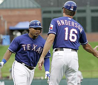 Marlon Byrd circles the bases during one of his two HRs, helping the Rangers end a two-game skid.  (AP)