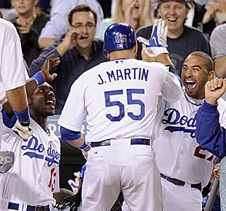 The Dodgers and their fans seem to be pleased with Russell Martin's decisive grand slam.  (AP)