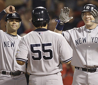 Roll out the red carpet for Hideki Matsui (55), who puts the wood to the Red Sox with two homers. (AP)