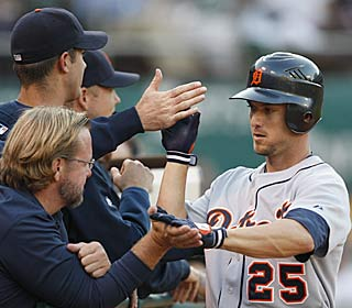 Ryan Raburn hits one of his two homers as the Tigers increase their division lead to 3 1/2 games.  (AP)