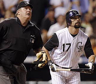 Todd Helton's 12th homer of the season helps the Rockies plate seven in the sixth inning.  (AP)