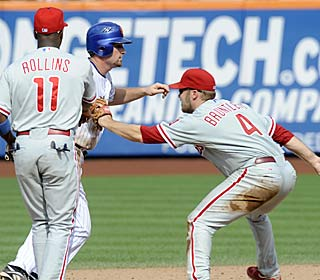 Eric Bruntlett completes the 15th unassisted triple play in big league history and the second to end a game.  (AP)