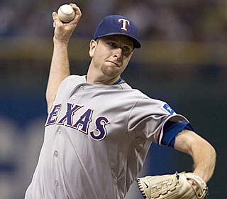 Scott Feldman improves to 13-4 by striking out 11 and allowing no runs in seven innings.  (AP)