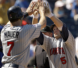 Michael Cuddyer (5) receives a high-five after hitting his second homer of an eight-run seventh inning.  (AP)