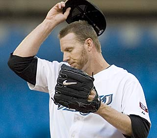 It's an unfamiliar feeling for Roy Halladay, who allows seven earned runs in six innings.  (AP)