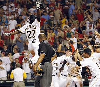 Andrew McCutchen gets some air while celebrating his eighth homer of the season in style. (AP)