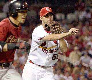 Adam Wainwright doesn't give an inch, giving up three hits with five K's in eight innings. (AP)