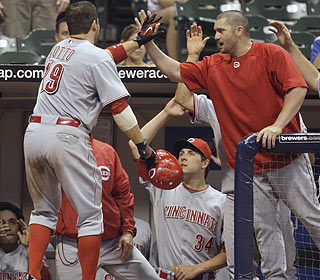 Joey Votto's 13th-inning HR brings joy to the Reds. Laynce Nix's bomb later is icing on the cake. (AP)