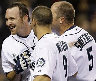 Ryan Langerhans is congratulated by Jack Wilson and Mike Sweeney after hitting the game-winning homer. (AP)