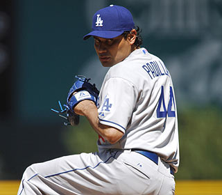 Vicente Padilla allows two runs and strikes out four in five innings in his Dodgers debut. (AP)