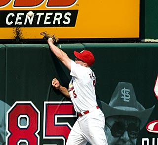 Matt Holliday leaps but can't reach Jeff Keppinger's game-deciding home run in the ninth.  (US Presswire)