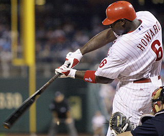 Ryan Howard goes 3 for 3 with three RBI and records his 22nd multihomer game and fifth of the season.  (AP)