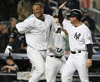 Robinson Cano is all smiles after turning on a Randy Williams 2-2, two-out pitch for the winner.  (US Presswire)