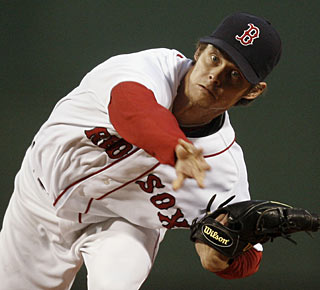 Clay Buchholz whiffs nine and allows just three singles in 8 1/3 innings. (AP)