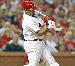 Albert Pujols, who picks up his 109th RBI, rips one of his two doubles for the streaking Cards.  (AP)