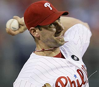 Cliff Lee suffers his first loss with the Phils, allowing 10 hits and six runs in five innings.  (AP)