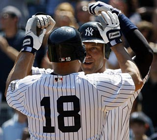 Johnny Damon (18), Derek Jeter and the Yankees have swept four of their past seven series at home.  (AP)