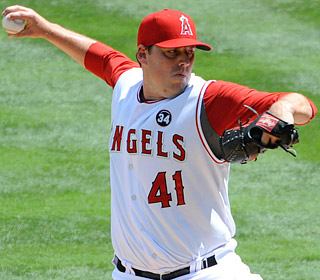 John Lackey strikes out six and becomes the fifth pitcher to win 100 games with the Angels.  (US Presswire)