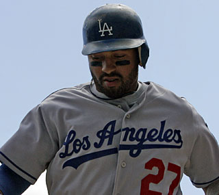 Matt Kemp helps put two runs on the board and the Dodgers need each one to beat the Reds.  (AP)