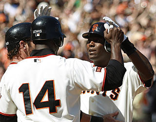 Edgar Renteria (right) gives the Giants a major lift in the seventh with a go-ahead grand slam.  (AP)
