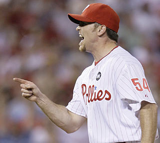 The Phillies end the game smoothly thanks to closer Brad Lidge, who pitches a perfect ninth inning.  (AP)