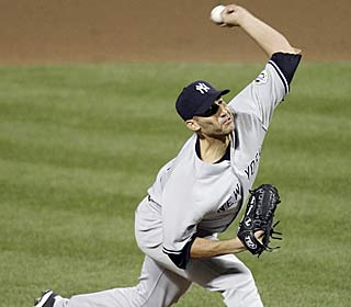 Andy Pettitte allows two hits and one run in eight innings, striking out eight to improve to 12-6.  (AP)