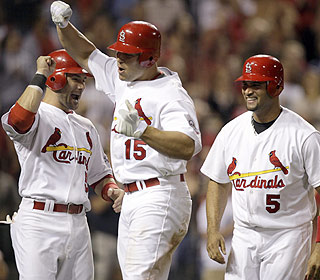 That's how it's done. Matt Holliday (center) rocks St. Louis with a three-run HR in the seventh inning.  (AP)