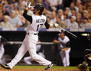 It's a picture-perfect looking swing ... and it is, as Todd Helton powers one out of the park. (AP)