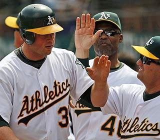 Landon Powell's grand slam gives him 27 RBI, second-most by an A's player in his first 36 games. (AP)