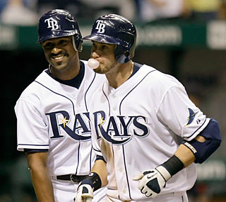 Fernando Perez celebrates with Evan Longoria, who hits a two-run homer in the bottom of the eighth.  (AP)