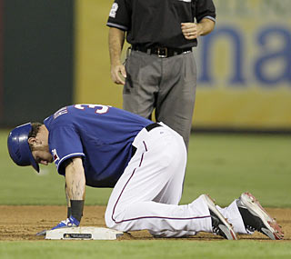 Josh Hamilton exits the game after aggravating his sore lower back with a headfirst slide into second base.  (AP)
