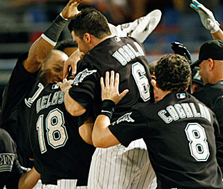The Marlins are a happy bunch again after Wes Helms (18) belts a walk-off home run in the ninth.  (AP)