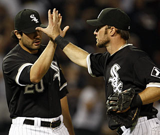 Chicago's Mark Kotsay (right) has a home run and three RBI against his former team. (AP)