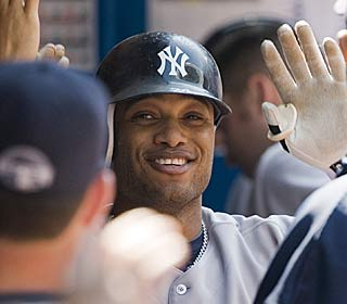 Robinson Cano gets some well-earned praise during his 3-for-4 day.  (AP)