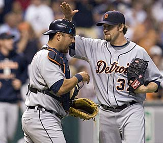 Catcher Gerald Laird greets reliever Brandon Lyon after Lyon locks up his second save.  (AP)