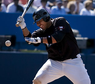 Randy Ruiz is hit in the face with a pitch from New York's Josh Towers in the fifth inning.  (Getty Images)