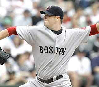 Red Sox lefty Jon Lester wins his fourth straight decision and hasn't lost since July 19.  (AP)