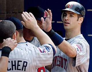 Twins catcher Joe Mauer finishes with three hits, including a two-run single in the first inning.  (AP)